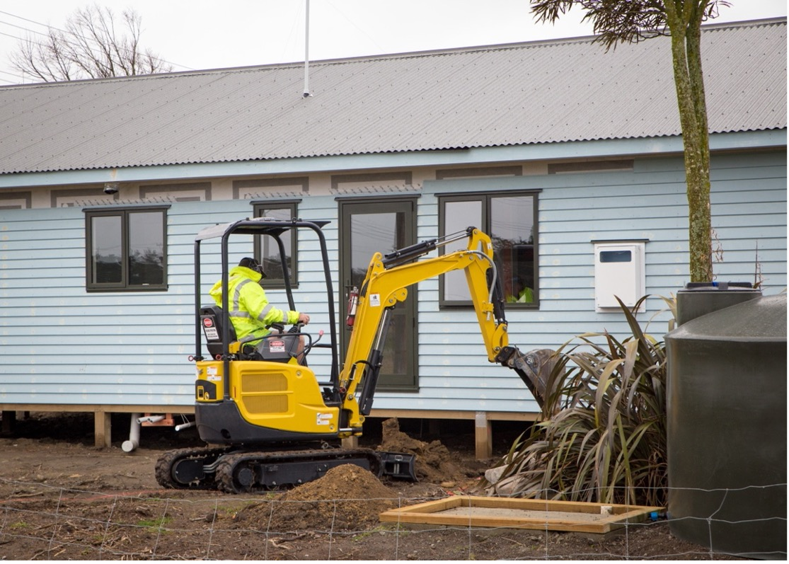 yaba homes worker building a modular home